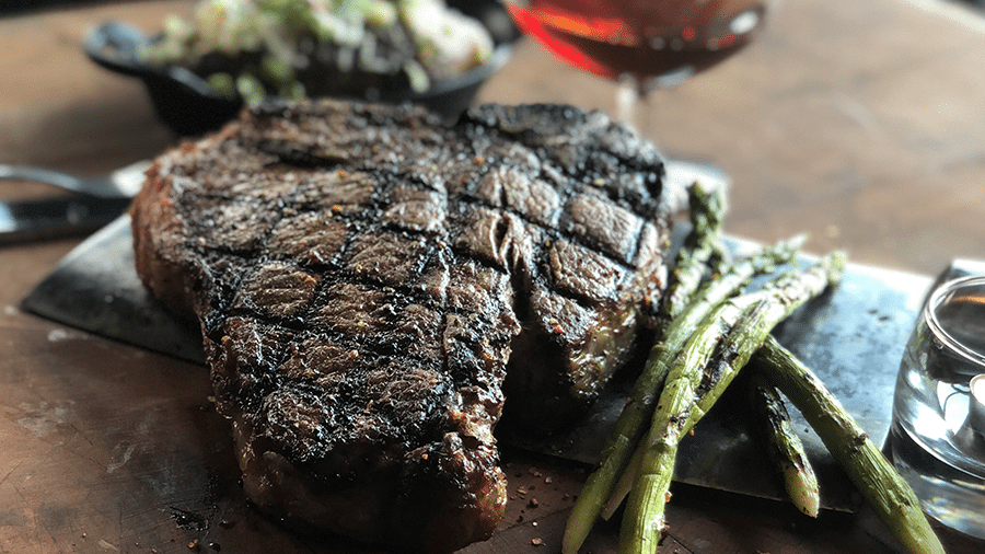 steak with asparagus and glass of wine
